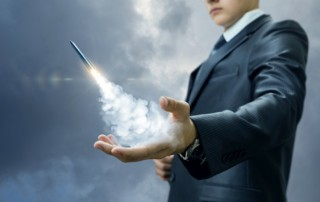 rocket launching from hand symbolizing accelerated results in business